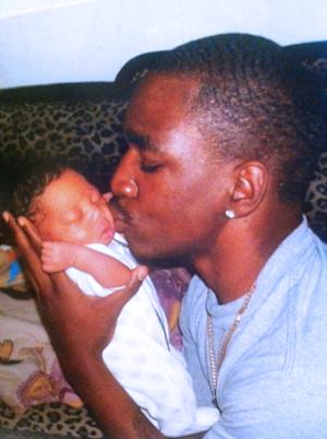 A photo releases by the McDade family shows Kendrec McDade kissing his baby brother Keion in March 2012.  Kendrec McDade was shot and killed by Pasadena police March 24, 2012 who believed the 19-year-old college student to be a robbery suspect.  (AP Photo/McDade Family)