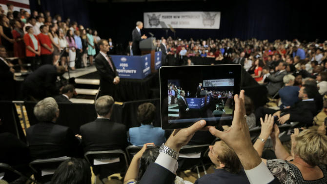 A members of the audience uses an iPad to record President Barack Obama speaking at Manor New Technology High School, Thursday, May 9, 2013 in Manor, Texas. (AP Photo/Pablo Martinez Monsivais)