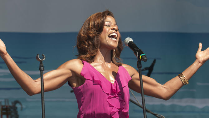 COMMERCIAL IMAGE In this photograph taken by AP Images for  AIDS Healthcare Foundation Nicole Henry sings the national anthem at the 2012 Florida AIDS Walk & Music Festival, sponsored by theAIDS Healthcare Foundation,on Sunday, May 20, 2012 at South Beach Park in Fort Lauderdale, Florida. 3400 walkers raised $826,000 to support HIV testing, prevention and medical treatment throughout Florida. AHF's mission is cutting-edge medicine and advocacy regardless of ability to pay. (Mitchell Zachs/AP Images for AIDS Healthcare Foundation)