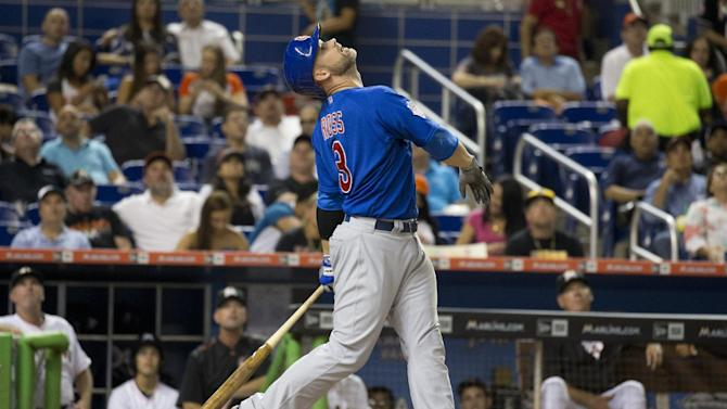 Chicago Cubs  David Ross (3) hits a foul ball during the second inning of a baseball game in Miami against the Miami Marlins, Tuesday, June 2, 2015. (AP Photo/J Pat Carter)