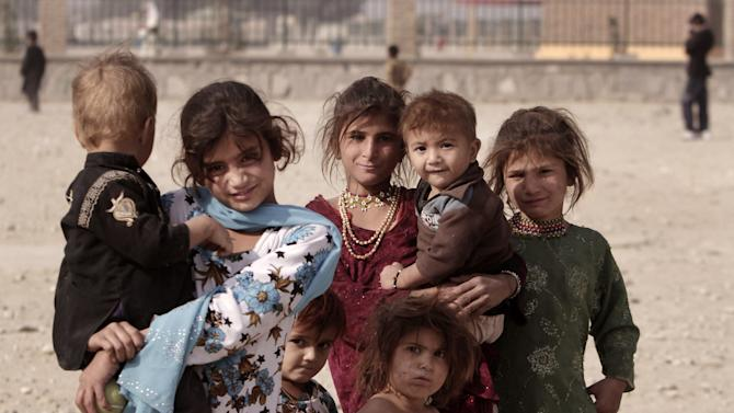 Afghan refuges children pose for a photograph on the outskirts of Jalalabad east of Kabul, Afghanistan, Tuesday, Nov 13, 2012. (AP Photo/Rahmat Gul)