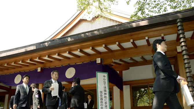 "A group of Japanese lawmakers leave after they offered prayers at the Yasukuni Shrine in Tokyo during an annual spring festival on Tuesday, April 23, 2013. Dozens of Japanese lawmakers paid homage at the national war shrine Tuesday morning, risking more anger from neighbors South Korea and China over visits they see as failures to acknowledge Japan's militaristic past. The sign reads "" Reception for lawmakers who support Yasukuni Shrine visit.""  (AP Photo/Kyodo News) JAPAN OUT, MANDATORY CREDIT, NO LICENSING IN CHINA, HONG KONG, JAPAN, SOUTH KOREA AND FRANCE"