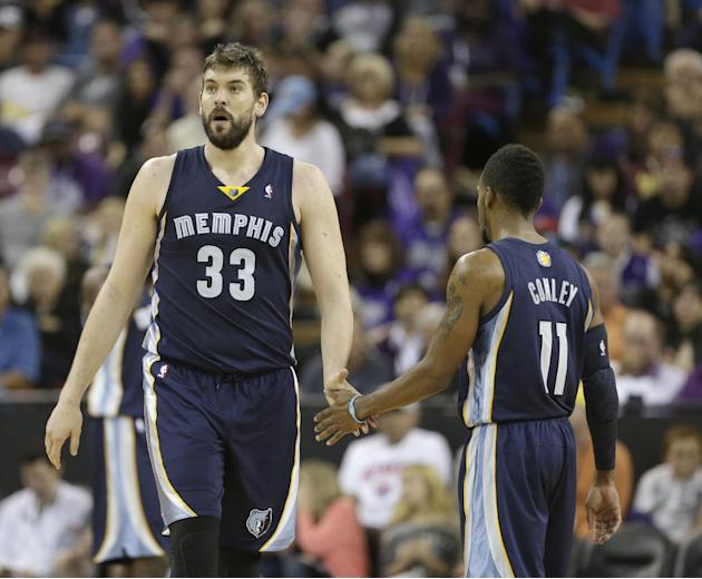 Memphis Grizzlies center Marc Gasol, left, of Spain, is congratulated by teammate Mike Conley after scoring late in the fourth quarter of an NBA basketball game in Sacramento, Calif., Sunday, Nov. 17,