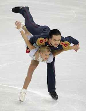 Volosozhar-Trankov lead pairs after short program