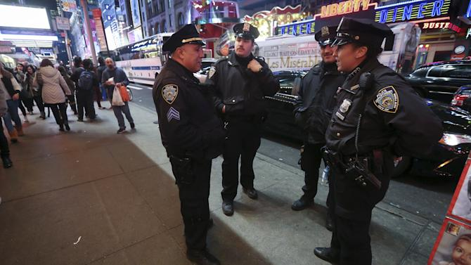 Police linger in Times Square after the Port Authority bus terminal was briefly closed and evacuated, in the Manhattan borough of New York