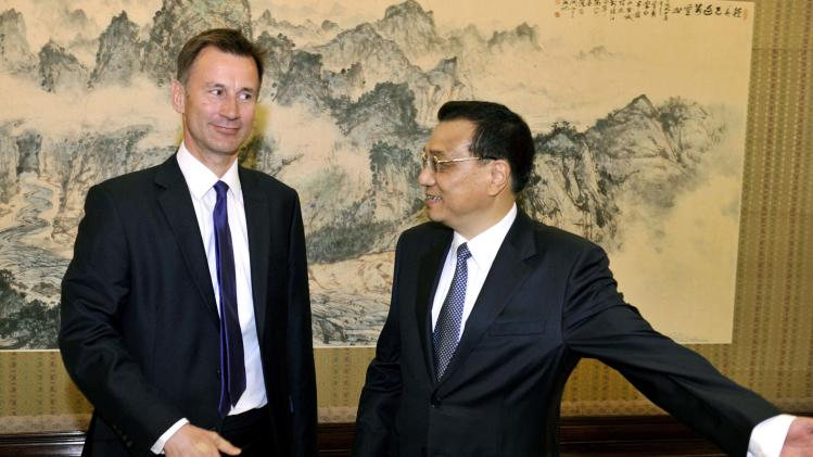Chinese Premier Li welcomes Britain's Health Minister Hunt before their meeting at Zhongnanhai in Beijing