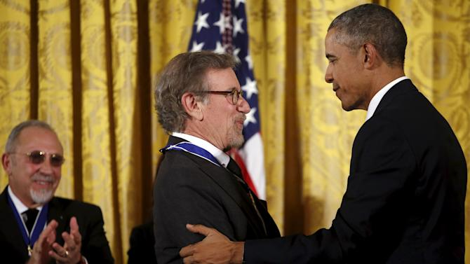 Director Steven Spielberg receives the Presidential Medal of Freedom from U.S. President Barack Obama during an event in the East Room of the White House in Washington