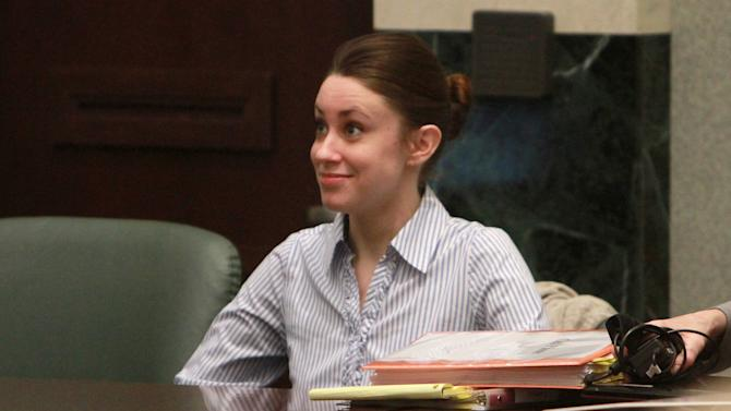 Casey Anthony smiles at one of her attorneys before the start of her murder trial Tuesday, June 7, 2011,at the Orange County Courthouse in Orlando, Fla. Anthony is charged with killing her 2-year old daughter in 2008. (AP Photo/Joe Burbank,Pool)