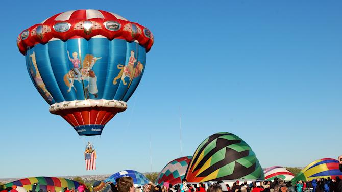 """In this Oct. 8, 2011 photo, the """"Carousel"""" hot air balloon is shown at the Albuquerque International Balloon Fiesta. The 41st annual event is set to begin Saturday and is expected to draw hundreds of thousands of spectators from around the country and the global. (AP Photo/Russell Contreras)"""