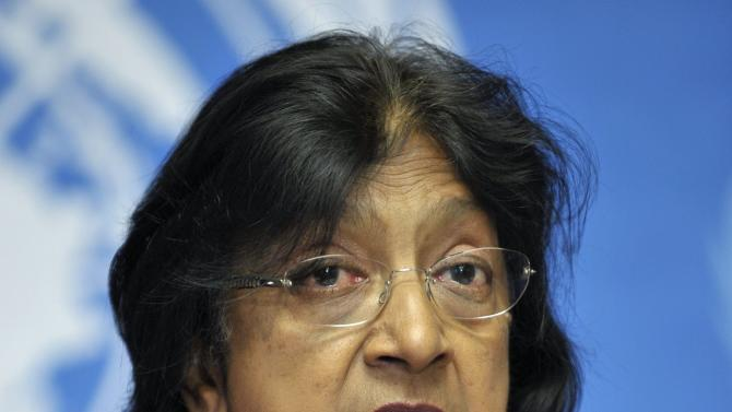 """South African Navanethem Pillay, U.N. High Commissioner for Human Rights, speaks during a press conference at the European headquarters of the United Nations in Geneva, Switzerland, Thursday, June 30, 2011. Pillay told reporters she was """"disappointed"""" that China welcomed Sudan's President Omar al-Bashir during a visit this week, rather than arrest him to ensure he stands trial. She said that """"the whole world favors trial"""" for al-Bashir for his role in the civil war in Sudan that killed more than 2 million people. (AP Photo/Keystone, Martial Trezzini) GERMANY OUT - AUSTRIA OUT"""