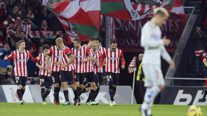 Athletic Bilbao players celebrate a goal against Atletico Madrid during their Spanish first division match in Bilbao