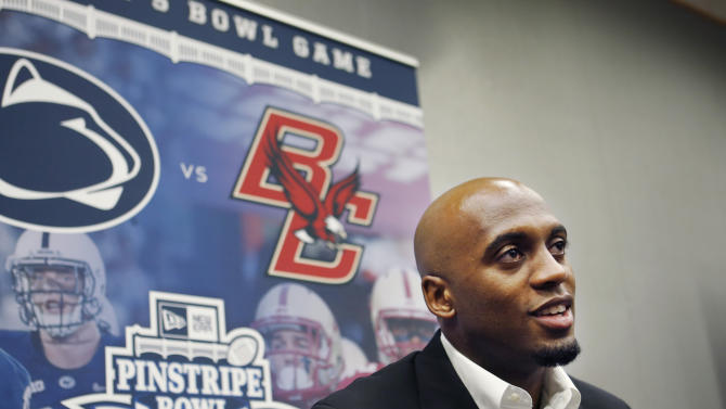 Boston College quarterback Tyler Murphy speaks to reporters during media day for Saturday's NCAA college football Pinstripe Bowl against Penn State, Wednesday, Dec. 24, 2014, at Yankee Stadium in New York. (AP Photo/Kathy Willens)