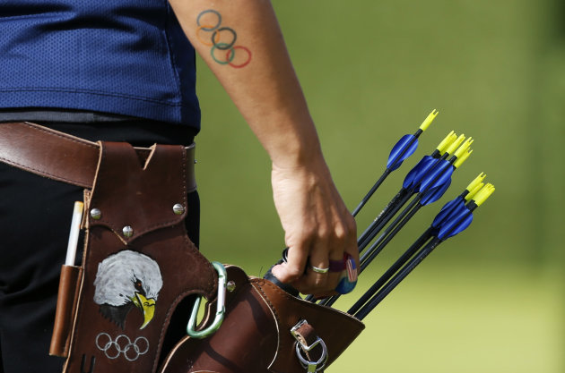 Khatuna Lorig of the U.S. reaches for an arrow from her quiver sporting a picture of an American bald eagle in the women's archery team quarterfinals at the Lords Cricket Ground during the London