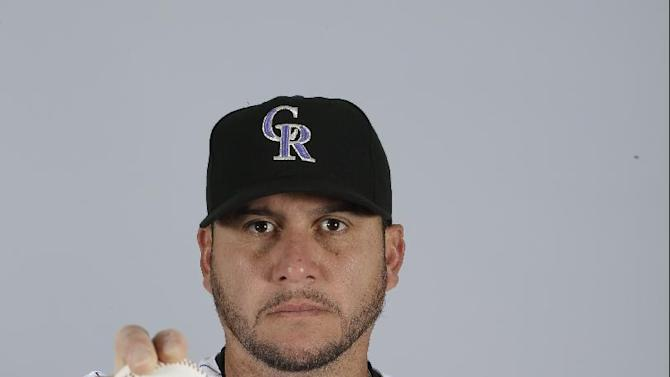 This is a 2015 photo of Rafael Betancourt of the Colorado Rockies baseball team. This image reflects the Rockies active roster as of March 1, 2015, when this image was taken. (AP Photo/Darron Cummings)