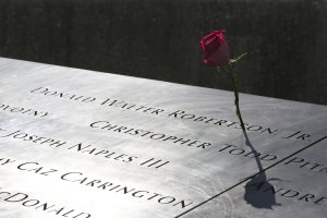 A rose is placed next to the name of a victim of the…