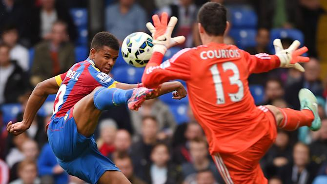 10ThingstoSeeSports - Crystal Palace's Fraizer Campbell, left, competes for the ball with Chelsea's Thibaut Courtois during their English Premier League soccer match at Selhurst Park, London, Saturday, Oct. 18, 2014. (AP Photo/Tim Ireland, File)
