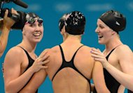 US swimmers Shannon Vreeland, Dana Vollmer, Allison Schmitt and Missy Franklin celebrate after the women's 4x200m freestyle relay final swimming event at the London 2012 Olympic Games in London