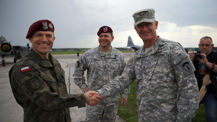 Polish General Adam Josk shakes hands with General Richard C. Longo in Swidwin