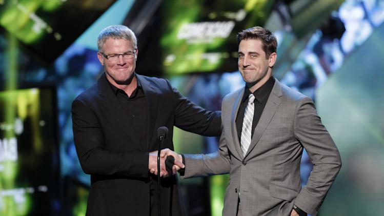Brett Favre, left, and Aaron Rodgers present at the 2nd Annual NFL Honors on Saturday, Feb. 2, 2013 in New Orleans. (Photo by AJ Mast/Invision/AP)