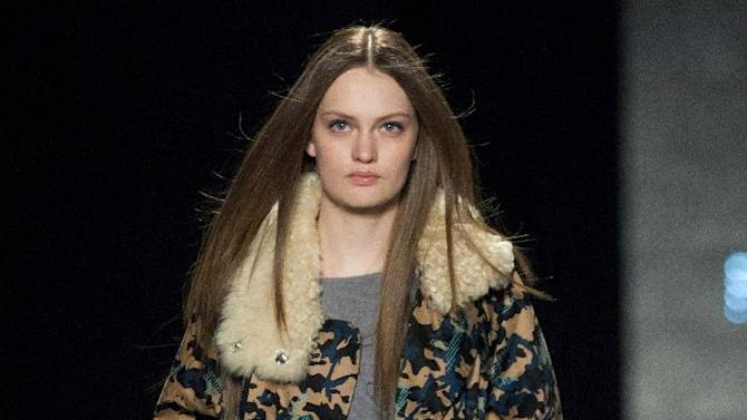 A model walks the runway during the Rebecca Minkoff Fall 2013 fashion show during Fashion Week, Friday, Feb. 8, 2013, in New York. (AP Photo/Karly Domb Sadof)