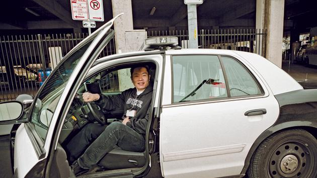 Policemen let Jiang sit in their car