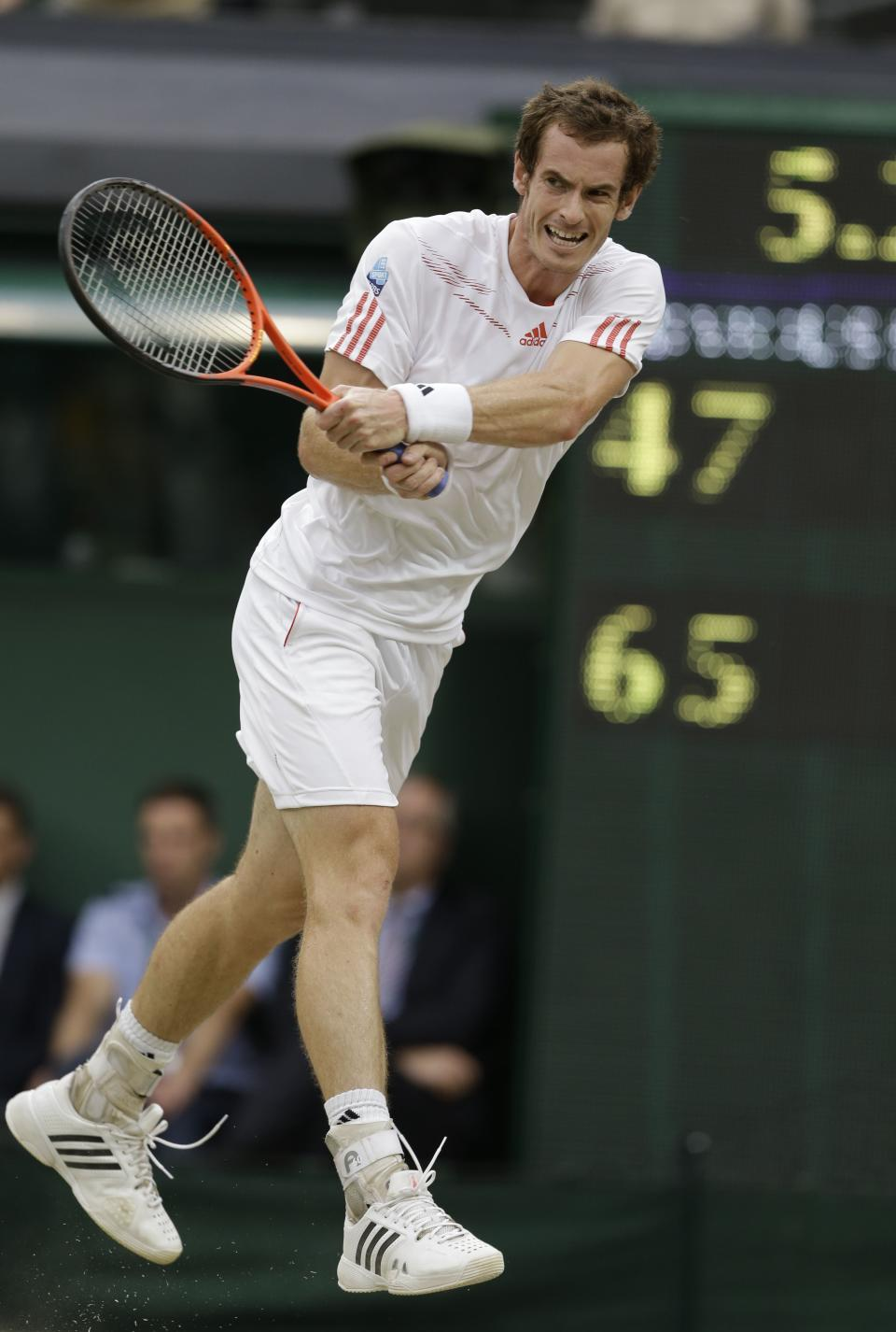 Andy Murray of Britain plays a shot to Roger Federer of Switzerland during the men's final match at the All England Lawn Tennis Championships at Wimbledon, England, Sunday, July 8, 2012. (AP Photo/Kirsty Wigglesworth)