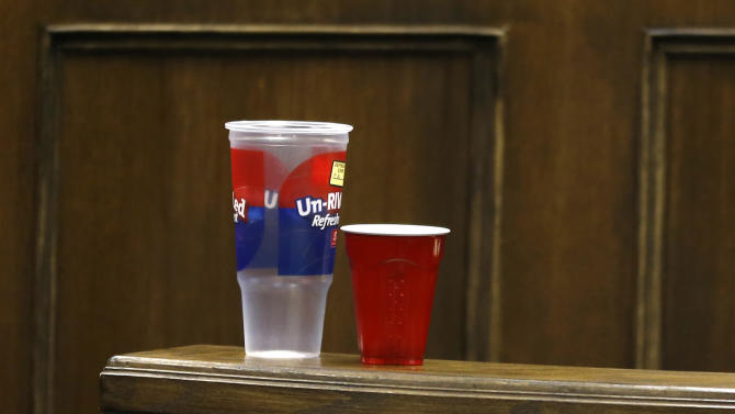 Two plastic cups are seen on a rail in juvenile court before the start of the third day of the rape trial for Trent Mays , 17, and Ma'lik Richmond, 16, on Friday, March 15, 2013 in Steubenville, Ohio. Defense council used the cups later during testimony to demonstrate the drinking game beer-pong. Mays and Richmond are accused of raping a 16-year-old West Virginia girl in August of 2012. (AP Photo/Keith Srakocic, Pool)