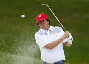 U.S. team member Jason Dufner hits from a sand trap on the fourth hole during the first practice round for the 2013 Presidents Cup golf tournament at Muirfield Village Golf Club in Dublin, Ohio