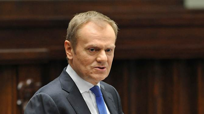 Poland's  Prime Minister Donald Tusk addresses lawmakers during a debate in the parliament in Warsaw, Poland, Tuesday, Feb. 19, 2013. The parliament opened a public discussion on whether and when Poland should adopt the European Union's common currency. (AP Photo/Alik Keplicz)