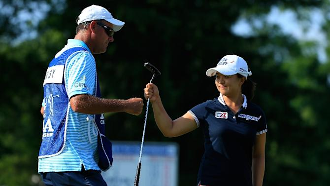 Caddie Paul Fusco and Kim Sei-Young of South Korea celebrate her par save on the 16th green during the KPMG Women's PGA Championship on June 14, 2015 in Harrison, New York