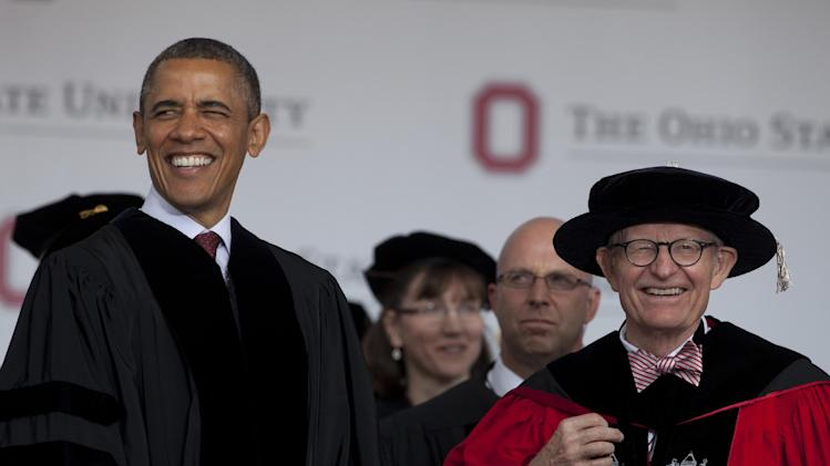 President Barack Obama and Ohio State University President E. Gordon Gee arrive at the Ohio State University spring commencement in the Ohio Stadium, Sunday, May 5, 2013,  in Columbus, Ohio. Obama is the third sitting president to give the commencement speech at Ohio State University. (AP Photo/Carolyn Kaster)