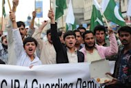 Pasban Pakistan supporters chant slogans in Karachi on January 15, 2013, as they support of a Supreme Court decision to arrest the prime minister over corruption allegations