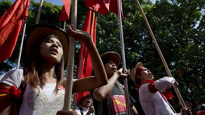 Student protesters shout slogans during a protest march in Letpadan, north of Yangon, Myanmar, Tuesday, Mar. 3. 2015. Hundreds of police formed a human chain around student protesters who were staging a sit-in on a road Tuesday after being blocked from marching to Yangon, Myanmar's biggest city, to protest a newly passed law that they say curbs academic freedom. (AP Photo/Gemunu Amarasinghe)