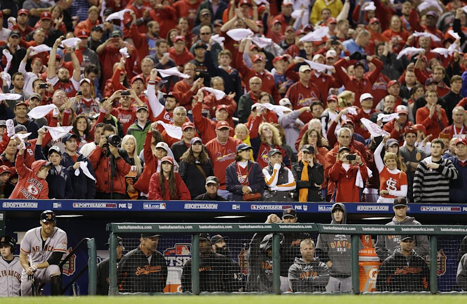 St. Louis Cardinals fans cheer during the ninth inning of Game 3 of baseball's National League championship series between the St. Louis Cardinals and the San Francisco Giants Wednesday, Oct. 17, 2012, in St. Louis. St. Louis won 3-1.(AP Photo/David J. Phillip)