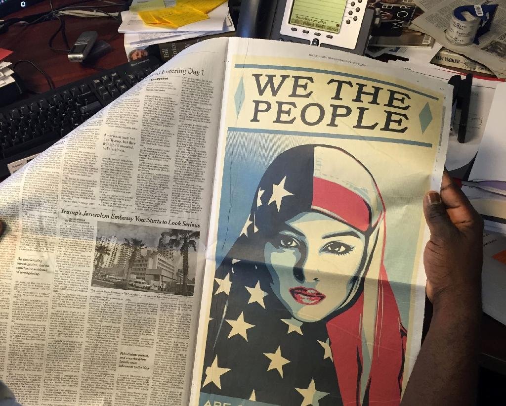 US newspapers carry woman-in-headscarf protest ads