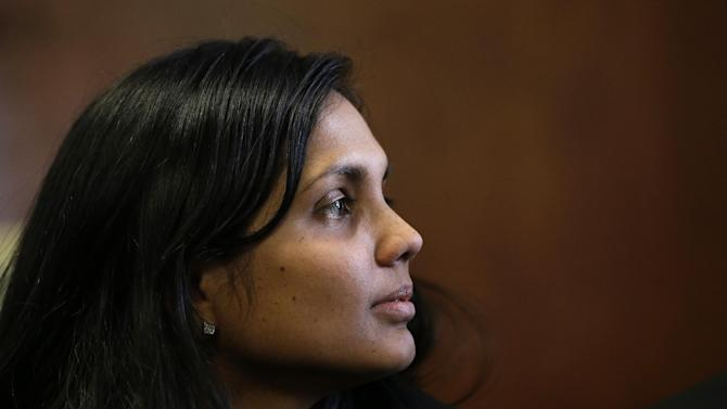 Annie Dookhan sits in Suffolk Superior Court moments before her arraignment in Boston, Thursday, Dec. 20, 2012. Dookhan, the former chemist at the center of a U.S. drug testing scandal, pleaded not guilty to charges including perjury and tampering with evidence. (AP Photo/Steven Senne, Pool)
