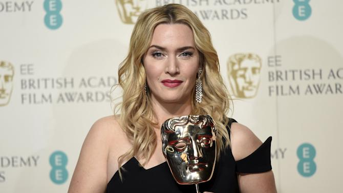 Kate Winslet poses with her awards for best supporting actress at the British Academy of Film and Television Arts (BAFTA) Awards at the Royal Opera House in London