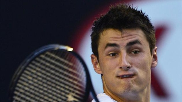 Bernard Tomic of Australia hits a return to Leonardo Mayer of Argentina during their men's singles match at the Australian Open tennis tournament in Melbourne (Reuters)