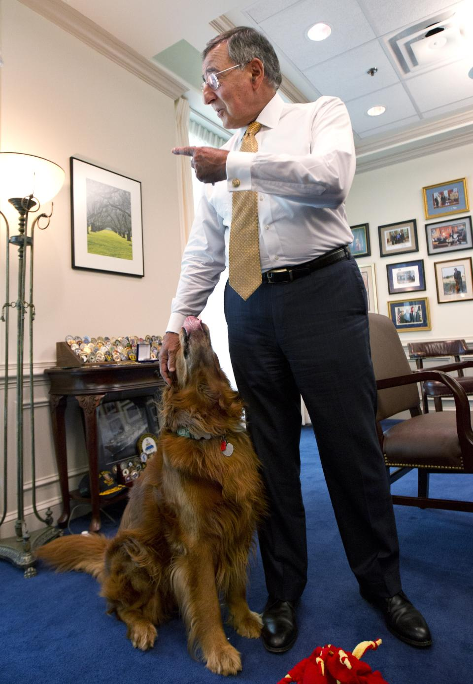 Defense Secretary Leon Panetta, with his golden retriever dog Bravo, during an interview with The Associated Press, Monday, Aug. 13, 2012, at the Pentagon.   (AP Photo Manuel Balce Ceneta)