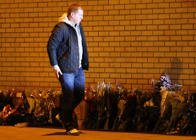 Celtic manager Neil Lennon leaves flowers near the scene of a helicopter crash in central Glasgow