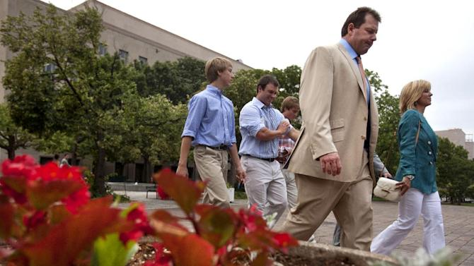 Former Major League Baseball pitcher Roger Clemens, front right, walks with his wife Debbie Clemens, and sons Kody, center, Koby, and Kacy, after leaving federal court in Washington, on Monday, June 18, 2012,after his acquittal on charges of lying to Congress in 2008 when he denied ever using performance-enhancing drugs.  (AP Photo/Jacquelyn Martin)
