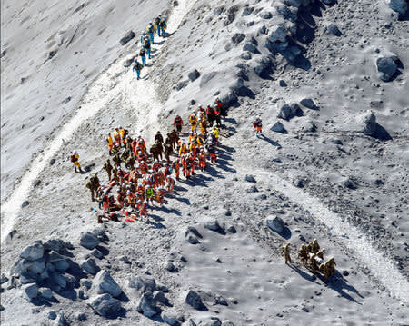 JSDF soldiers and firefighters conduct rescue operations near the peak of Mt. Ontake, which straddles Nagano and Gifu prefectures, central Japan