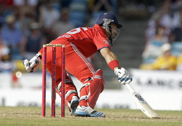 England's Michael Lumb runs during the first T20 International cricket match against West Indies at the Kensington Oval in Bridgetown, Barbados, Sunday, March 9, 2014