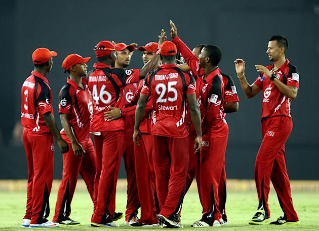 Titans and Trinidad & Tobago players celebrate fall of a wicket during the CLT20 match between Titans and Trinidad & Tobago at Sardar Patel Stadium, Motera in Ahmedabad on Sept. 30, 2013. (Photo: IANS