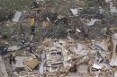 Rescue workers go through the debris of a house left flattened by a tornado in this aerial photograph taken over Granbury, Texas