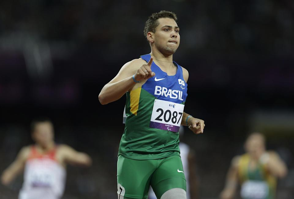 Brazil's Alan Fonteles Cardoso Oliveira celebrates after winning a men's 200m T44 round 1 race at the 2012 Paralympics in London, Saturday, Sept. 1, 2012. (AP Photo/Lefteris Pitarakis)