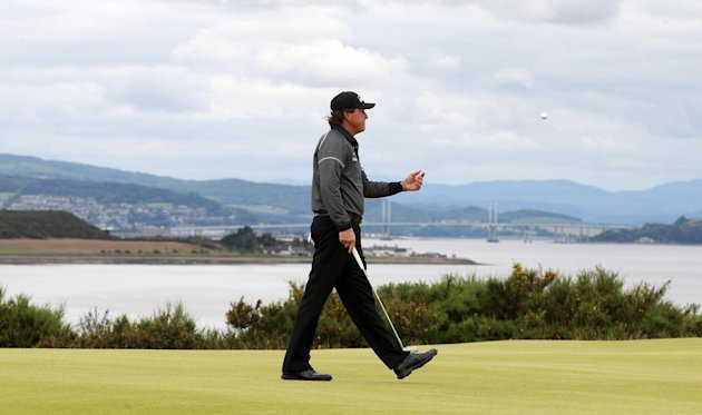 Phil Mickelson of the US walks on the 9th hole during day two of the Scottish Open at the Castle Stuart Golf Links, Inverness, Scotland, Friday July 13, 2012. (AP Photo/PA, Lynne Cameron) UNITED KINGDOM OUT NO SALES NO ARCHIVE