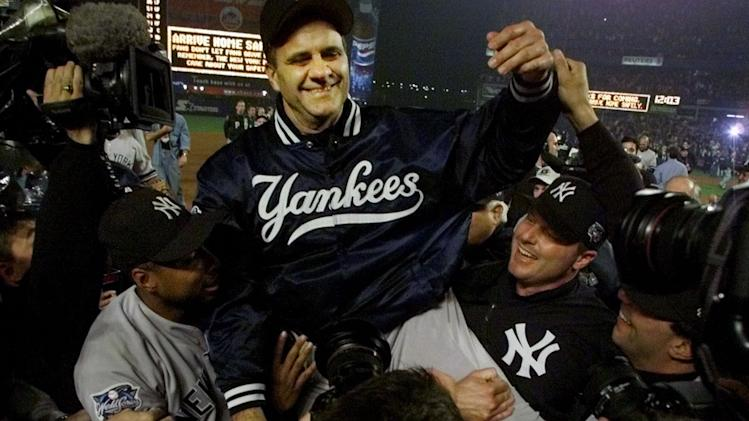 ADVANCE FOR WEEKEND EDITIONS, JULY 26-27 - FILE - In this Oct. 27, 2000 file photo, New York Yankees manager Joe Torre is carried off the field by players Bernie Williams, left, and Roger Clemens, right, after clinching the World Series by beating the New York Mets 4-2 in Game 5 of the World Series at Shea Stadium in New York. Torre will be inducted into the Baseball Hall of Fame in Cooperstown, N.Y., on Sunday, July 27, 2014. (AP Photo/Amy Sancetta , File)