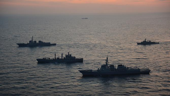 In this photo released by South Korean Joint Chiefs of Staff via Yonhap, South Korean and U.S. warships participate in their joint military drills in South Korea's East Sea on Monday, Feb. 4, 2013. South Korean and U.S. troops began naval drills Monday in a show of force partly directed at North Korea amid signs that Pyongyang will soon carry out a threat to conduct its third atomic test. (AP Photo/South Korean Joint Chiefs of Staff via Yonhap) KOREA OUT