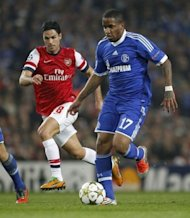 Schalke's Jefferson Farfan (R) vies with Arsenal's Mikel Arteta during their UEFA Champions League Group B match at the Emirates stadium in London. Schalke won 2-0